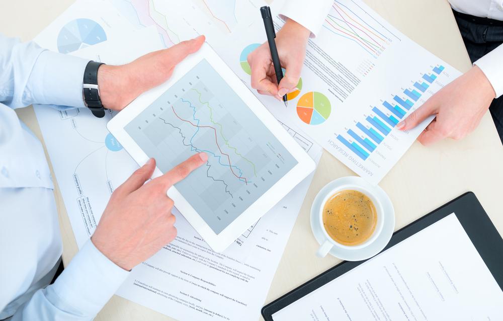 Two business associates working on metrics.