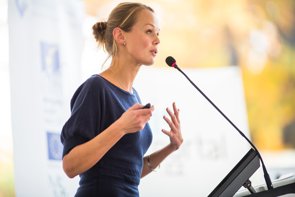 A woman presenting at a conference